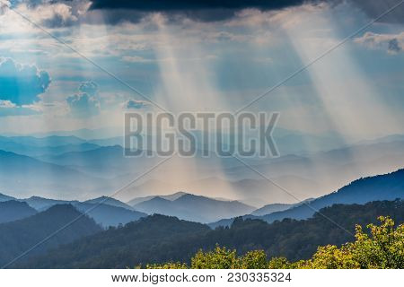 Clouds Above Sun Rays Shining On The Blue Ridge Mountains In North Carolina