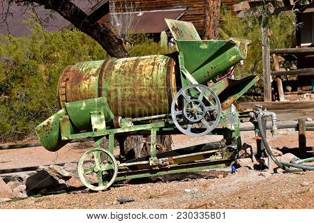 Am Old Antiquated Portable Cement Mixer Operated By A Pulley
