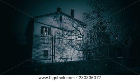 Old Abandoned And Desolate Horror House At Night