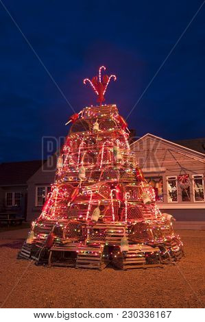 Brightly Lit Lobster Trap Holiday Tree At Dusk Is A Seacoast Tradition In New England.