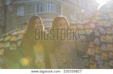 Paris,france-february 25,2018: Backlit Portrait With Lens Flares Of Unidentified Vietnamese Happy Gi