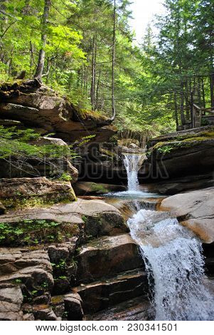 A Small Waterfall In New Hampshires White Mountains.