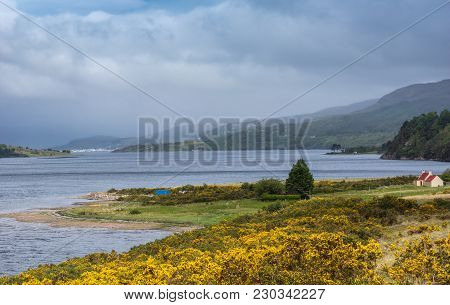 Ullapool, Scotland - June 8, 2012: Looking Over Loch Broom To Ullapool Under Heavy Cloudscape Shows