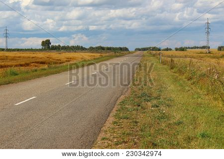 The Road Between Fields In Siberia, Russia