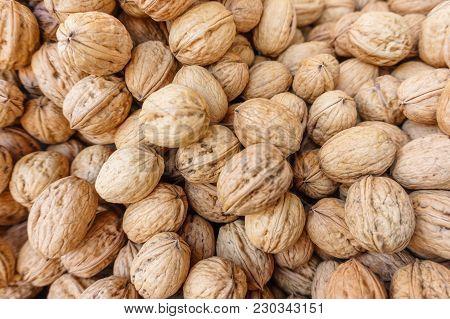 Group Of European Walnuts In Peel, Natural Food Background, Healthy Food