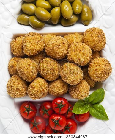 Healthy Italian Appetizer Tray With Risotto Balls Arancini , Green Olives , Tomato And Red Wine. Par
