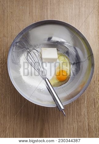 Eggs , Butter , Flour And Whisk In A Bowl . Cooking Homemade Sweets .