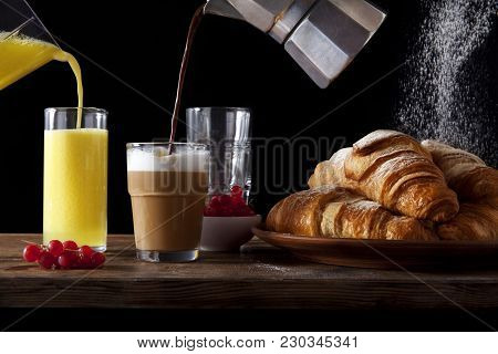 Table Breakfast. Fresh Hot Croissants, Pouring Orange Juice, Pouring Coffee Into Milk. Ripe Berries
