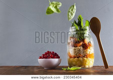 Mason Jars With Hot Salad: Chickpeas, Arrots, Quinoa, Roasted Pumpkin And Spinach. Ripe Red Currants