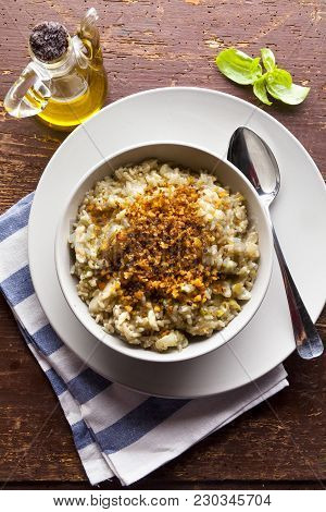 Italian Risotto With Cauliflower On A Wooden Table
