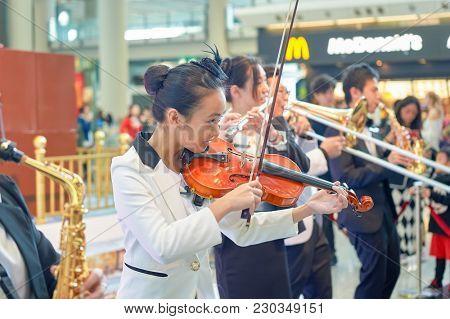 HONG KONG - DECEMBER 24, 2015: Instrumental Flash Mob in Hong Kong Interntational Airport. Hong Kong Interntational Airport is the main airport in Hong Kong.