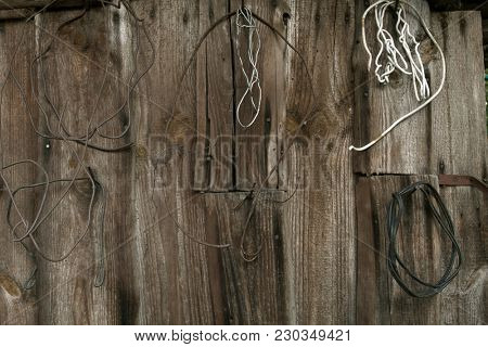Old wooden wall with rusty objects. Countryside style