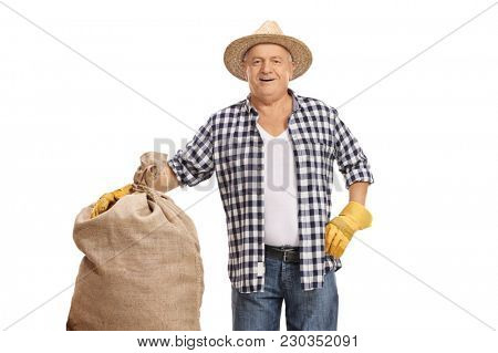 Elderly farmer with a burlap sack isolated on white background