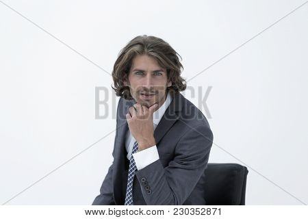 Portrait businessman sitting on chair and thinking