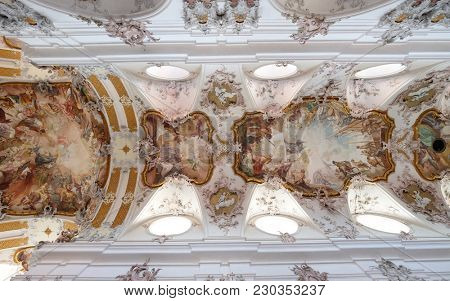 AMORBACH, GERMANY - JULY 08: Fresco painting on the ceiling in Amorbach Benedictine monastery church in the district of Miltenberg in Lower Franconia in Bavaria, Germany on July 08, 2017.