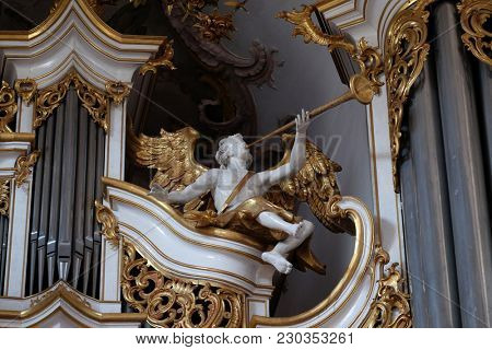 AMORBACH, GERMANY - JULY 08: Angel statue on the organ in Amorbach Benedictine monastery church in the district of Miltenberg in Lower Franconia in Bavaria, Germany on July 08, 2017.