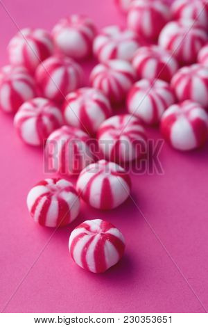 Traditional pink and white striped sweet bonbons.