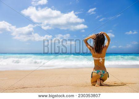 Woman suntanning at the beach