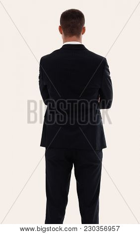 rear view.confident businessman with briefcase