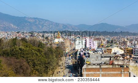 Boudhanath road and Boudhanath stupa as seen from a vantage point in Kathmandu, Nepal