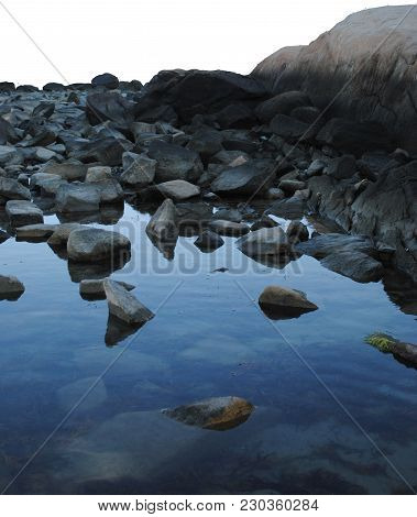 A Tide Pool With Beach Rocks And Water Reflections, Png File Version Also.
