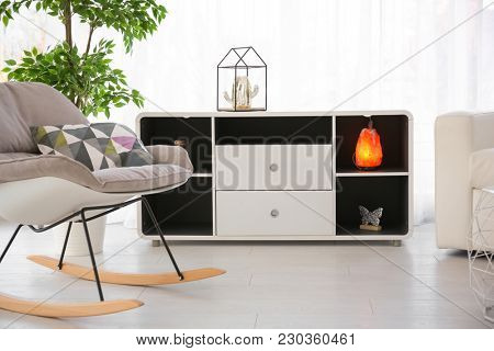 Room interior with himalayan salt lamp and rocking chair