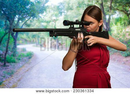 Girl Aiming With Gun, outdoor