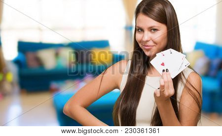 Young Woman Holding Playing Cards in a lounge