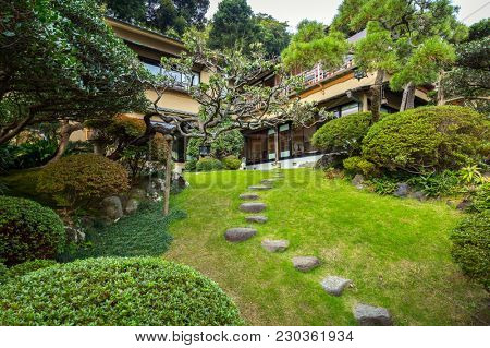 Kamakura, Japan - November 10, 2016: Traditional architecture with oriental garden in Kamakura, Japan. Kamakura is a city in Kanagawa Prefecture of Japan.