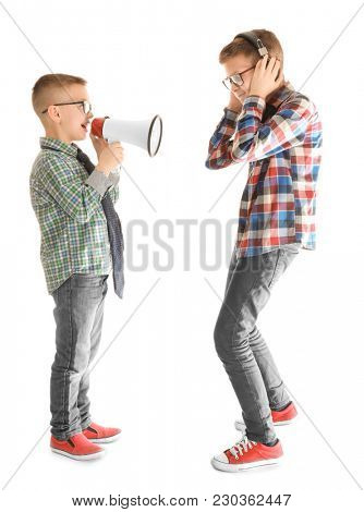 Cute little boy ignoring his friend with megaphone, on white background