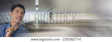 Digital composite of Businessman thinking and holding pen in office with transition