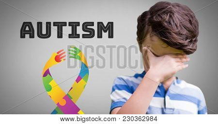 Digital composite of Boy against grey background with autism and colorful hope hands ribbon