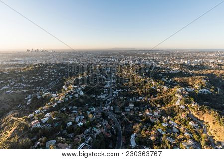 Aerial morning view of hillside homes in the Beachwood Canyon neighborhood near Griffith Park in Los Angeles California.