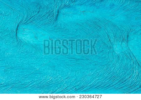 Unevenly Painted Surface Of Blue Color With Cracks And  With Wavy Irregular Pattern.  Background, Te