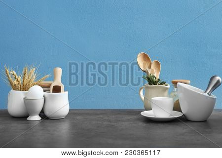 Different cooking utensils on table