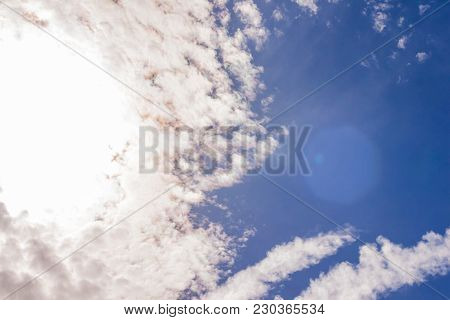 Amazing Cumulus Cloudscape Formation With Bright Sun Light Peeking Through Clouds With Sun Flare, Gr