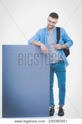 Portrait of a smiling male student holding blank board. Education opportunities. College student.