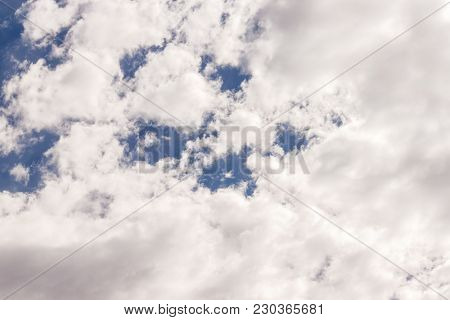 Amazing cumulus cloudscape formation showing only few spot of blue sky, great background for your next project poster