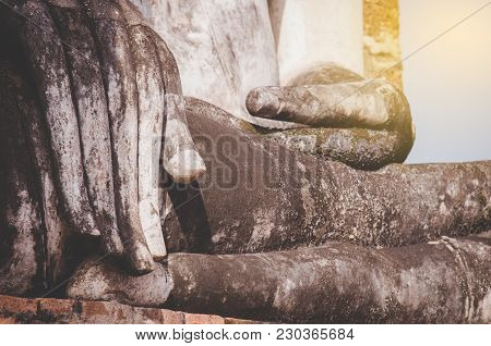 Hand Of An Ancient Buddha Image At Sukhothai Historical Park, Thailand.the Hand Of The Buddha Is Loc