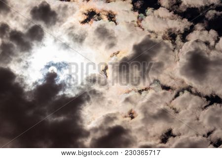 Beautiful Dark Sky Clouds With Sun Light Peeking Through The Clouds, Great Background For Your Next