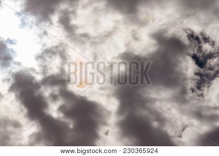 Beautiful Dark Sky Cloudscape Formation With Sun Light Peeking Through The Clouds, Great Background