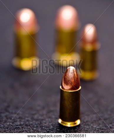 Two 9mm Full Metal Jacket Bullets And Two .45 Caliber Full Metal Jacket Bullets. Three Of The Rounds