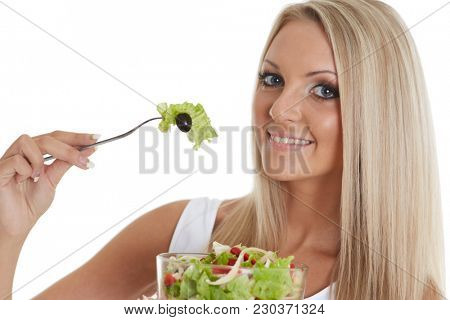 Slender young woman holds a bowl of salad  on a white background. Concept of healthy lifestyle.