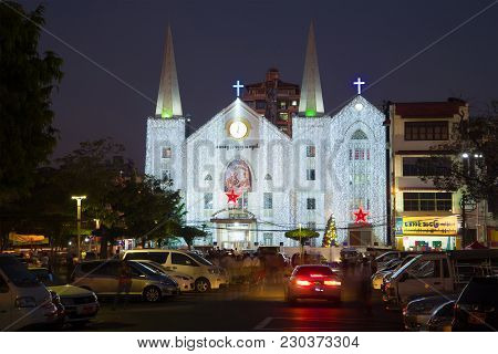 Yangon, Myanmar - December 18, 2016: View Of The Baptist Church Of St. Immanuel In The Christmas Ill