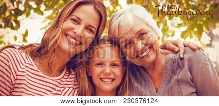 Illustration of happy thanksgiving day text greeting against portrait of happy family with granny