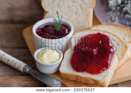 Delicious Toast Bread Served With Butter And Spread With Strawberry Jam. Homemade Bread And Jam On W