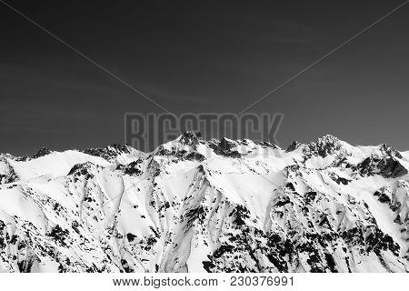 Black And White Snow Covered Mountains At Sun Cold Day. View From Region Dombay, Caucasus Mountains