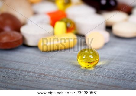Dietary Supplements And Vitamins Closeup On Wooden Board