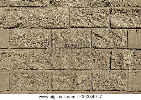 Grey concrete wall. Grunge concrete wall. Grey wall. Grunge wall. Grey background. Grunge background. Brickwork. Grunge brickwork. Decorative concrete tiles.