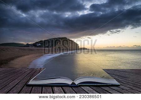 Creative Book Image Of Beautiful Vibrant Long Exposure Sunrise Landscape Image Of West Bay In Dorset